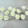 The Ivory Foam Rose Garland