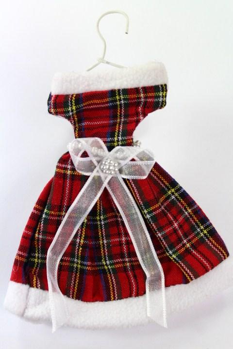Tartan dress on a hanger. Small hidden gift bags